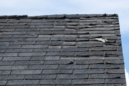 Badly damage roof shingles