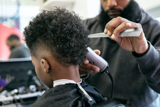 Barber: Anonymous Young Man Getting A Haircut