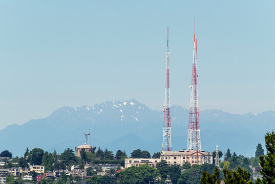Partial view of the Queen Anne neighborhood in Seattle with its radio towers and Olympic Mountains in the back.