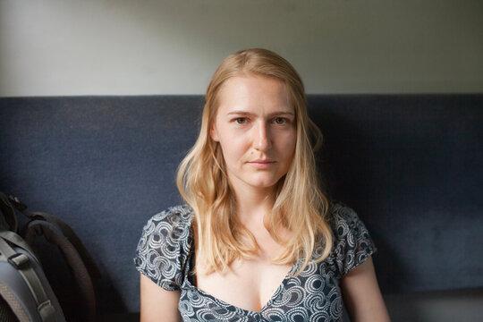 portrait of a blonde girl in a train car
