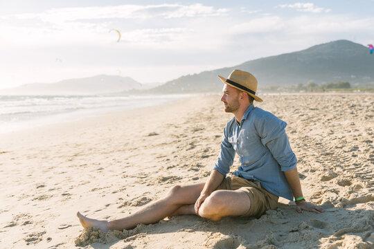 Young man enjoying at the beach
