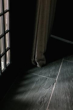 Light streaming through dark and moody room.