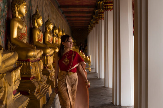 Asian woman visiting a temple in Thailand