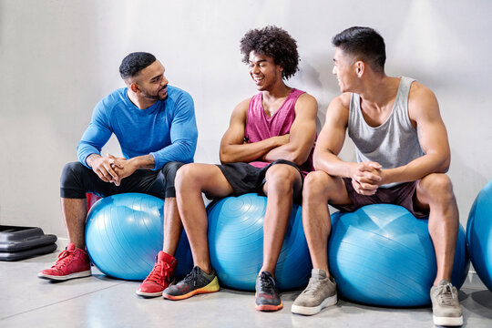 Sporty fitness multiethnic partners laughing together after work