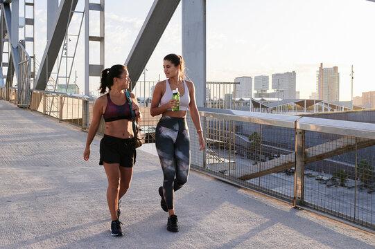 Sporty women walking in the city.