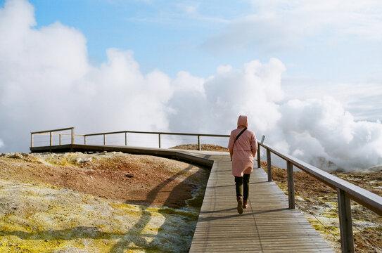 Woman walking in Gunnuhver Hot Springs area