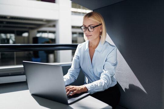 Businesswoman working in a pod