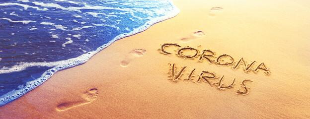 Corona virus written in the sand on vacation - fototapety na wymiar