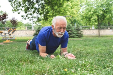 Man doing plank exercise at park