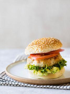 Chicken Burger with tomato and avocado smash
