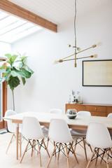 Brass Mid Century Light Fixture in Bright Dining Room