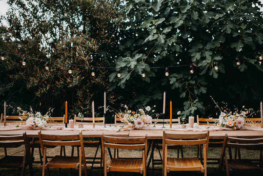 Bohemian wedding table with flowers and string lights