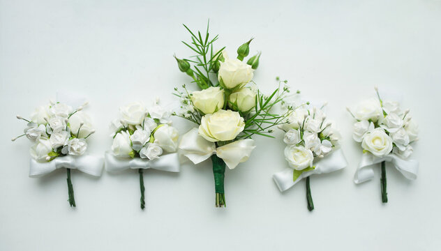 beautifully laid out boutonnieres on a white background
