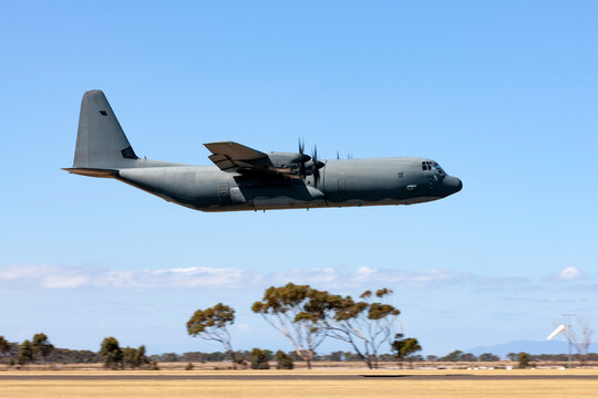 Large military transport aircraft flying at low level.