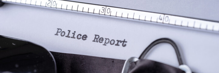 Police Report written with a vintage typewriter. Panoramic image
