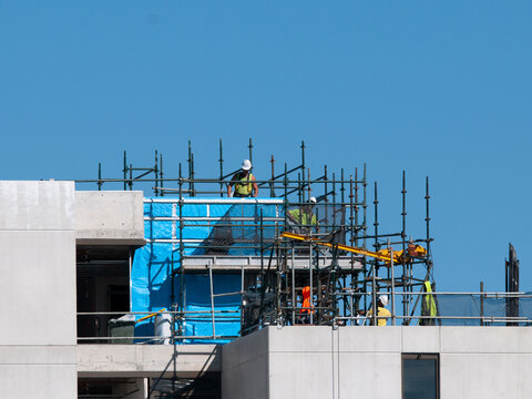 Workmen on the new Multistory Unit building under construction at 277 Mann St. Gosford. May 11, 2020. Building series.