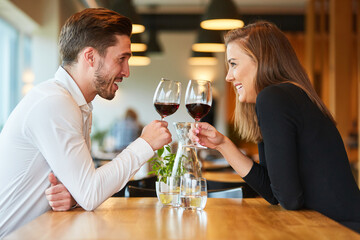 Couple in love drinking wine in the restaurant