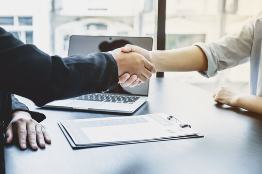hands shake after business office executives are interviewing job applicants in the meeting room
