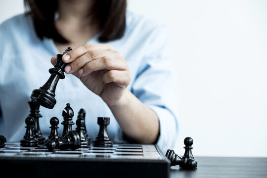 hand move chess with strategy and tactic to win enemy, play battle on board game, business opportunity  competition strategic challenge concept