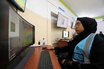 Somali analyst monitors the weather patterns, in Mogadishu