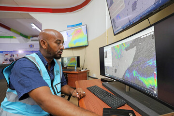 Khadar Sheikh Mohamed director of the new national disaster early warning centre designed to help Somalia predict disasters monitors the weather patterns, in Mogadishu