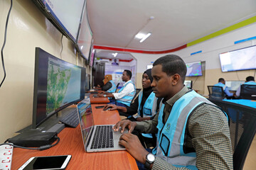 Somali analysts monitor the weather patterns at the early warning centre designed to help Somalia predict disasters in Wadajir district of Mogadishu