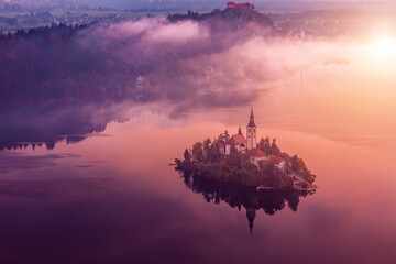 Colorful sunrise on Bled lake. Pilgrimage Church of the Assumption of Maria.  Bled lake, Julian Alps, Slovenia, Europe.