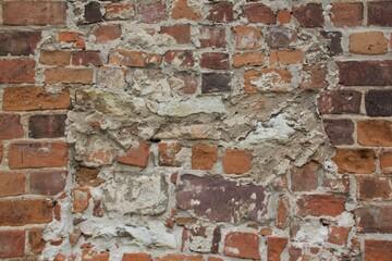 Obraz Większy fragment ceglanego nieregularnego muru - fototapety do salonu