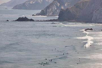 Spanish surfers coastline beach in basque country. Spelana, Spain