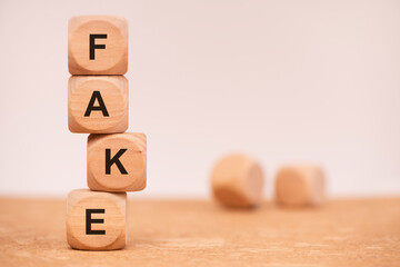 fact and fake news written on cubes