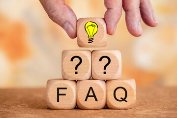 frequently asked questions printed on wooden cubes