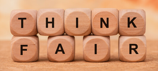 think fair printed on wooden cubes