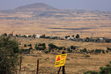 "A ""Danger, Mines"" sign is seen at the Israeli-controlled Golan Heights near the Israel-Syria frontier"