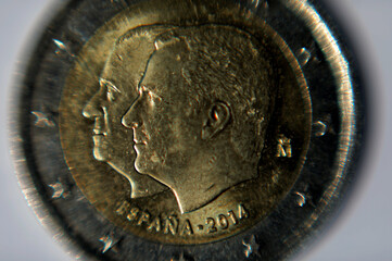 Two Euro coin with the faces of Spain's former King Juan Carlos I and Spain's King Felipe VI is seen in this illustration picture
