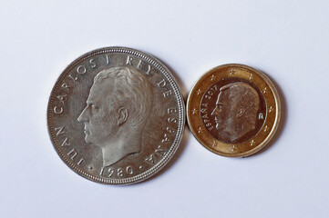 Spanish 50 pesetas coin with the face of Spain's former King Juan Carlos I and one Euro coin with the face of Spain's King Felipe VI, are seen in this illustration picture