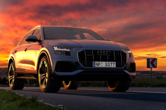Audi Q8, a luxury sports SUV on the road during a beautiful sunset