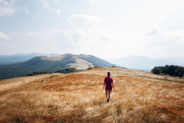 Alone girl in against the backdrop of an incredible autumn mountains landscape