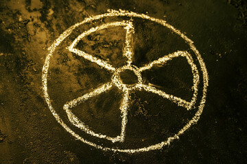 symbol of nuclear weapons and radiation on a black background close up