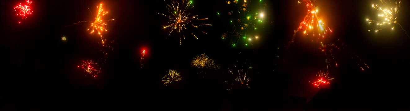 New Year's Eve panorama with colorful fireworks in the night sky Explosions happiness tradition end of year new year hilarious celebrate environment fireworks celebrate new beginning happy new year