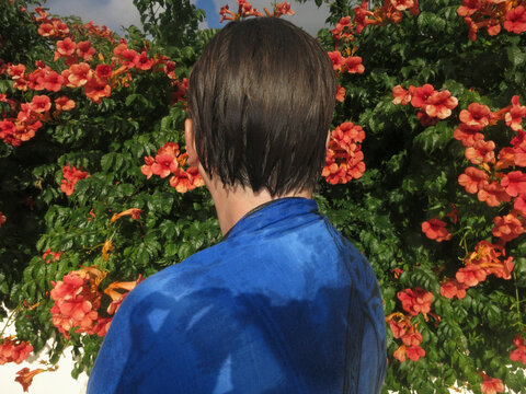 Close up of woman with wet hair standing in garden