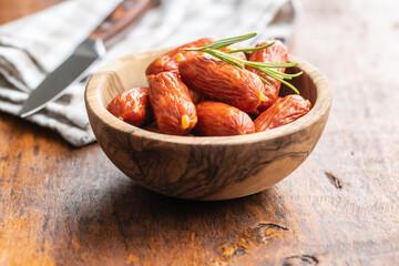 Mini salami sausages in bowl.