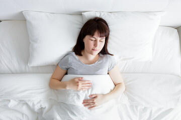 top view of young woman sleeping at home
