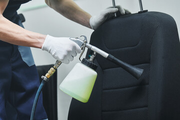 car detailing. cloth seat upholstery cleaning with high pressure air pulse cleaning gun