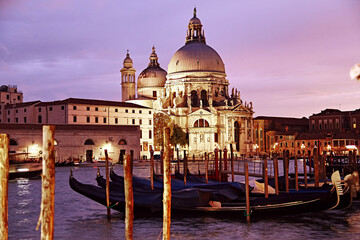 Beautiful view on gondolas and cathedral in venice on sunset