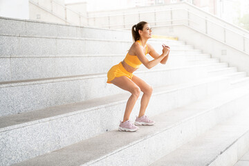 Woman in sportswear workout outdoor.