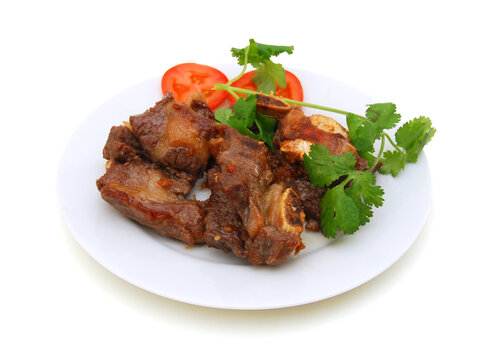 Beef ribs with tomato on white background