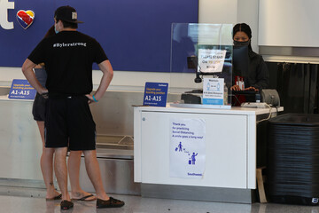 A Southwest Airlines customer service desk is seen with a social distancing advisory at LAX airport, as the global outbreak of the coronavirus disease (COVID-19) continues, in Los Angeles
