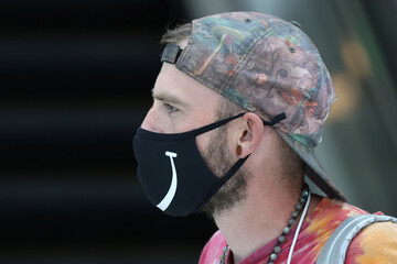 An airline passenger wears a mask at LAX airport, as the global outbreak of the coronavirus disease (COVID-19) continues, in Los Angeles