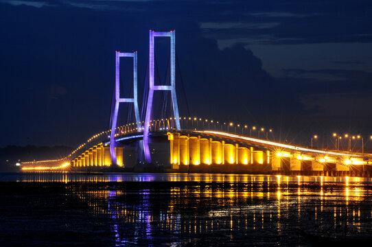 Night light, Suramadu bridge in Indonesia connects Java Island and Madura Island in Surabaya, East Java, Indonesia