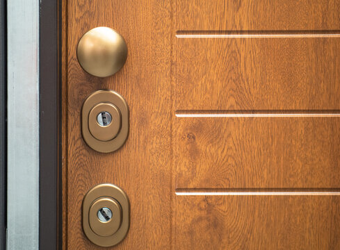 armored door in light wood with double safety lock and round handle